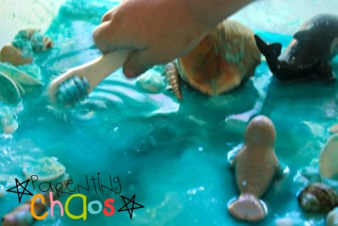 Sea Life Sensory Bin - Cleaning off the Animals