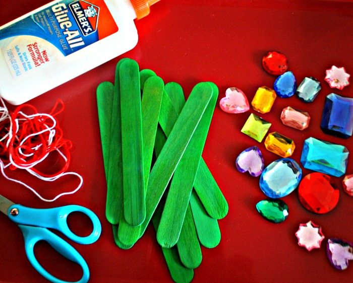 Craft materials needed for Popsicle stick Christmas tree ornaments