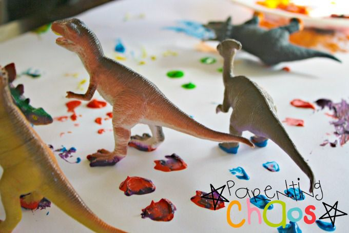 Dinosaurs Stomping Across Paper with Paint on their Feet