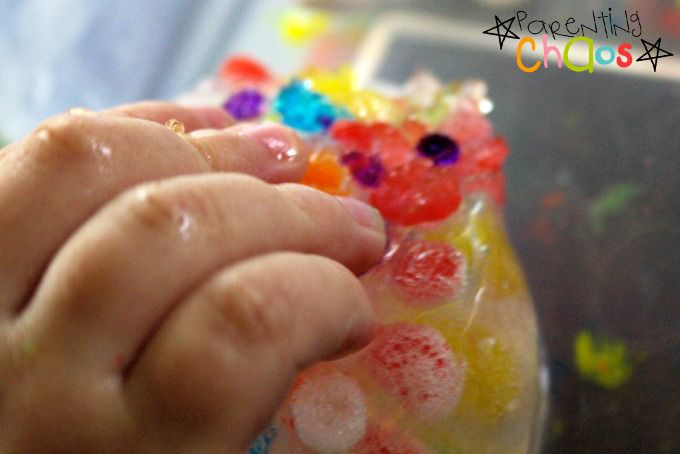 touching frozen water beads