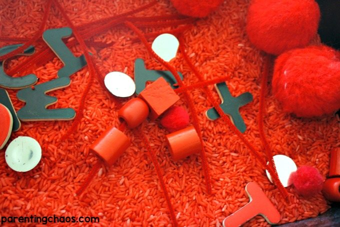 Activities such as this red sensory bin are a great way to start introducing colors in a playful stress-free manner.