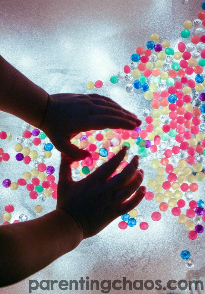 Playing with water beads and shaving cream on the light table is so simple and mesmerizing! My kids would LOVE this!