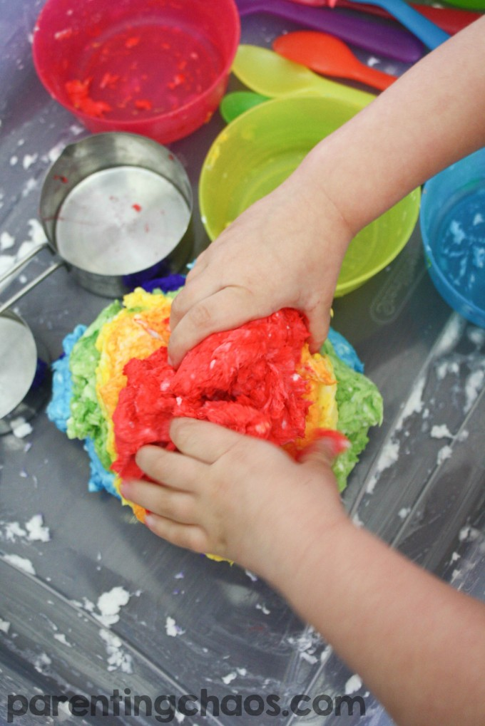 Ever had your child soak a roll of toilet paper? Instead of throwing it away turn it into this super fun Rainbow Clean Mud!