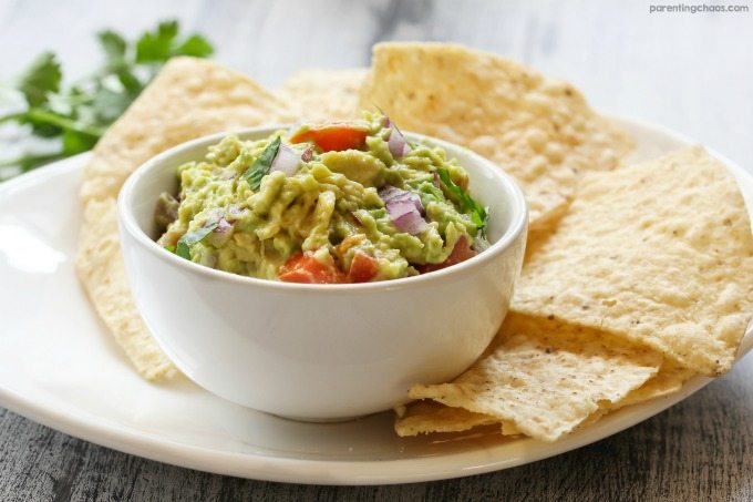 Fresh Guacamole is one of those dishes that is easy to make and meets just about every diet out there (gluten free, dairy free, vegan, vegetarian, paleo, Whole 30, primal, etc). This makes it the perfect dish to bring for summer potlucks and get togethers. I promise - this quick and easy guacamole recipe is foolproof to make and bound to be a crowd-pleaser.