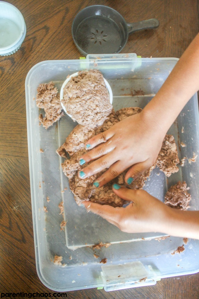 Ever had your child soak a roll of toilet paper? Instead of throwing it away turn it into this super fun Chocolate Scented Clean Mud!