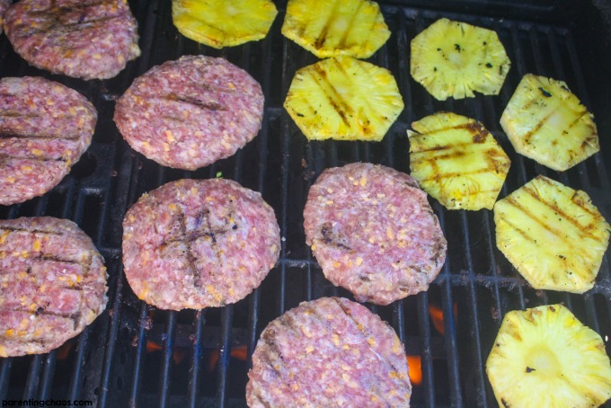 This Hawaiian brat burger blends the classic hamburger with the classic flavors of bratwurst. Topped with delicious grilled pineapple this is a must try grill recipes.