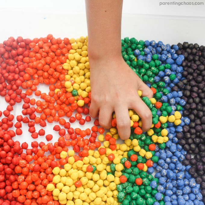 Rainbow Dyed Chickpeas are a quick and easy sensory bin filler that kids will love!
