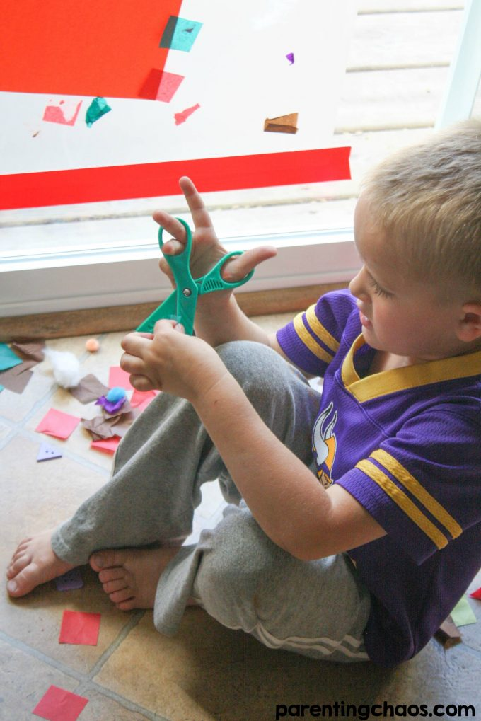 Providing open-ended creative activities such as this Scissor Skills Sticky Window Mural is a great way to encourage kids to continue to build upon their skills while controlling the mess.