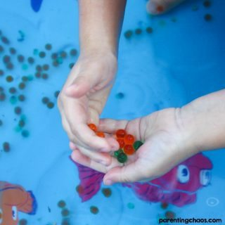 Previously, we've discovered ways to explore with water beads. Another favorite of ours is a sensory pool as it's great for the visual sensory system.