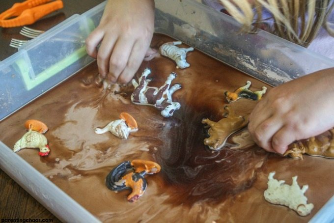 Sensory bins are a great activity for kids - easy, fun, and wonderful for developing fine motor skills. Your kids will love this simple Chocolate Mud Recipe!