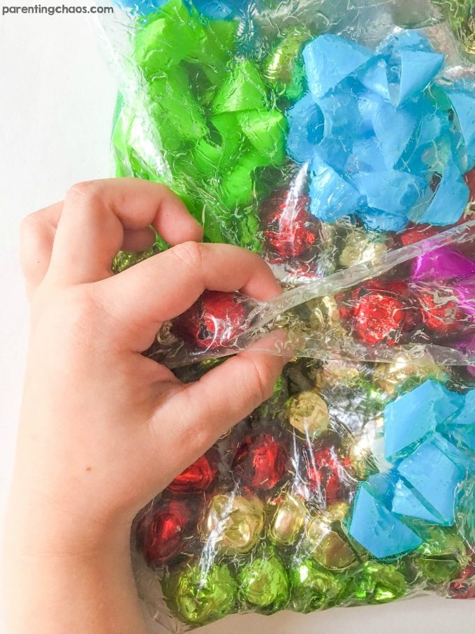 Make Jingle Bell Sensory Bags for kids to squish and play. These are fantastic taped to a window too!
