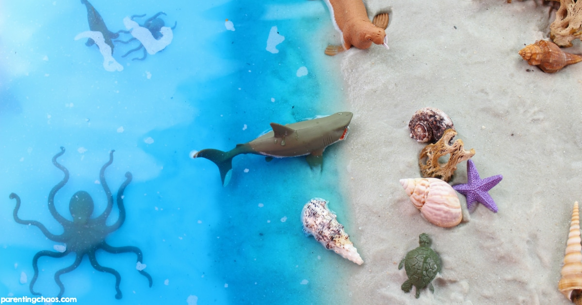 sand and water ocean themed sensory bin parenting chaos